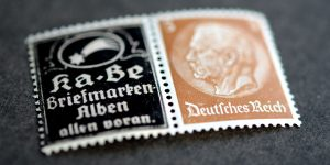Advertisement of KaBe Albums on stamps